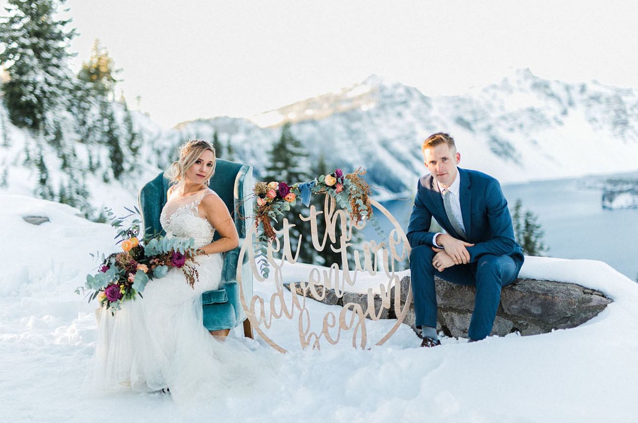 The groom was wearing a blue suit with a pale blue tie and a white shirt to highlight the snowy setting