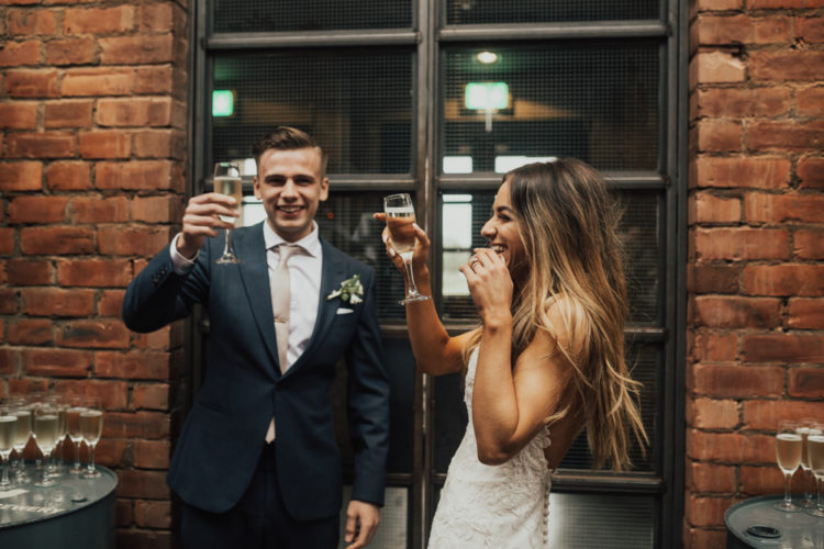 The groom was wearing a navy suit, white shirt, champagne tie and oxblood shoes