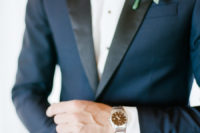 05 The groom was wearing a navy tuxedo with black lapels and a bow tie