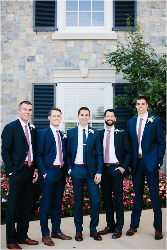 a chic combo of navy suits and pink ties is a cool modern idea