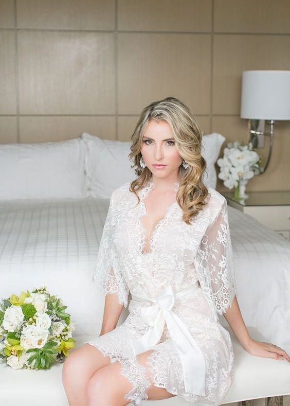 a chic short lace bridal robe with half sleeves and a sash plus a matching garter for a wow look during getting ready