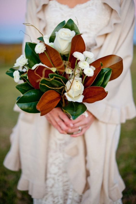 a magnolia leaf wedding bouquet with white blooms looks timeless