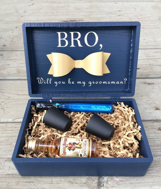 a navy box with cups, alcohol and some other stuff your bro may like