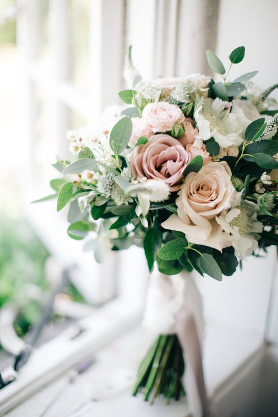 blush, dusty pink and white rose bouquet with greenery for a spring wedding