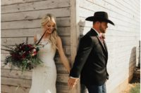05 navy jeans, a black jacket, a white shirt, a bold tie and a cowboy hat for a ranch wedding