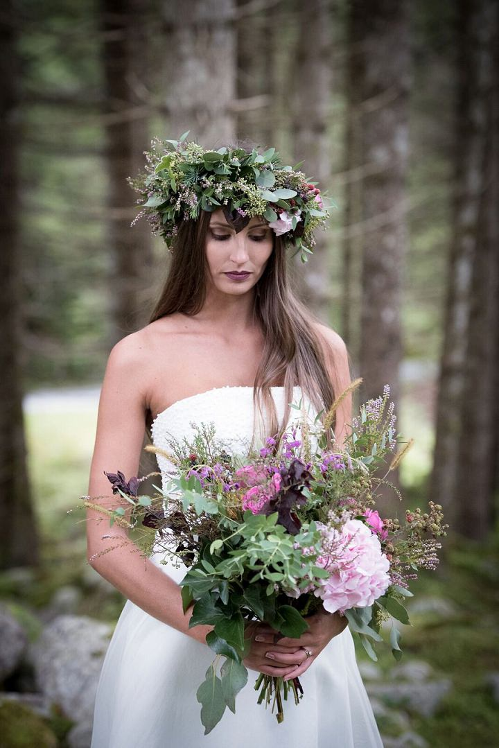 she rocked a berry lip, a lush greenery crown with flowers and berries and a matching bouquet