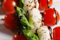 05 skewers with cherry tomatoes, arugula, mozzarella and balsamic drizzle are always a good idea