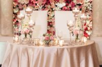05 wall of fresh blooms in the shades of pink for a refined and romantic look