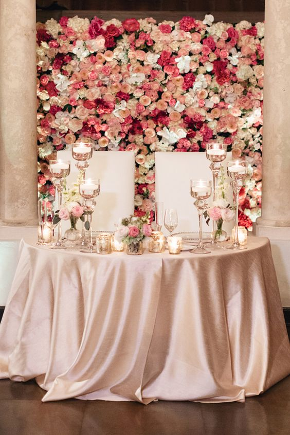 wall of fresh blooms in the shades of pink for a refined and romantic look