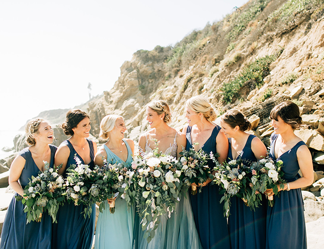 The bridal party was wearing navy gowns and a sea foam dress for the maid of honor