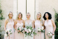 06 The bridesmaids were wearing mismatching blush gowns and holding romantic blooms