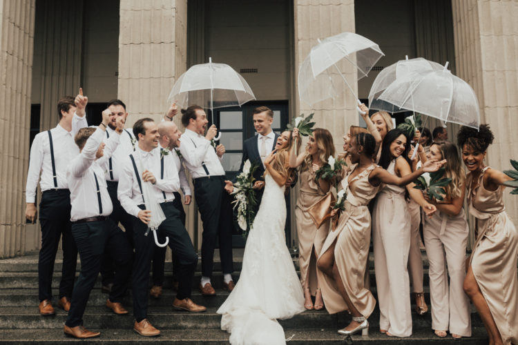 The bridesmaids were wearing blush and champagne outfits and the groomsmen opted for black suspenders and pants