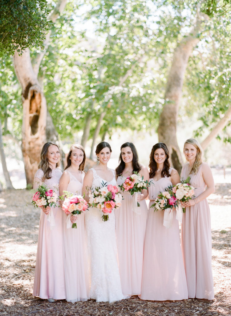 The bridesmaids were wearing mismatched blush gowns