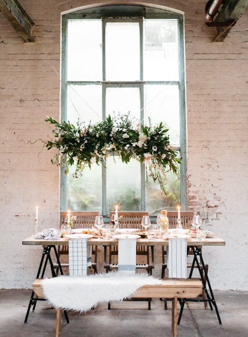 The main decoration was a lush greenery and floral installation over the tablescape