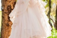 06 a blush strapless sweetheart neckline wedding ballgown with a ruffled skirt and floral appliques all over the dress