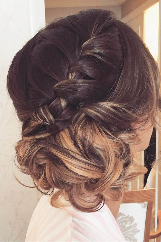 a braided crown going down to a low bun for those who have long hair