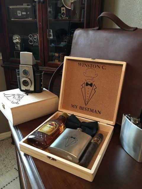 a chic box with a metal flask, a cigar and a bottle of favorite alcohol to send to your friend