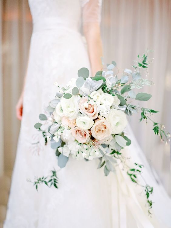 a classic white and blush rose bouquet with eucalyptus will fit many color schemes and bridal looks