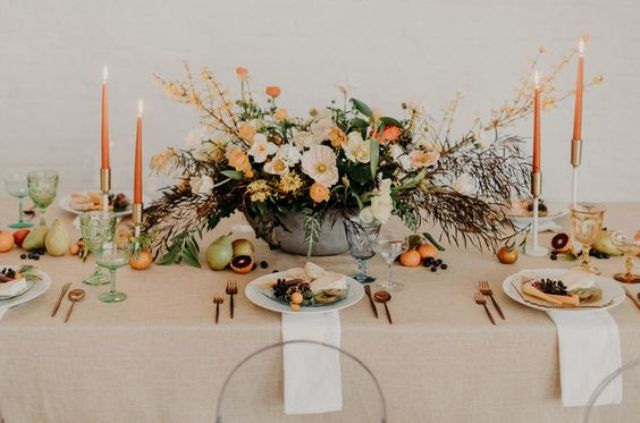 a modern moody tablescape with touches of orange, green and yellow looks bold and spring-like
