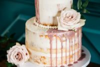 06 a naked wedding cake with dusty pink dripping, blush blooms and edible pearls for an elegant touch