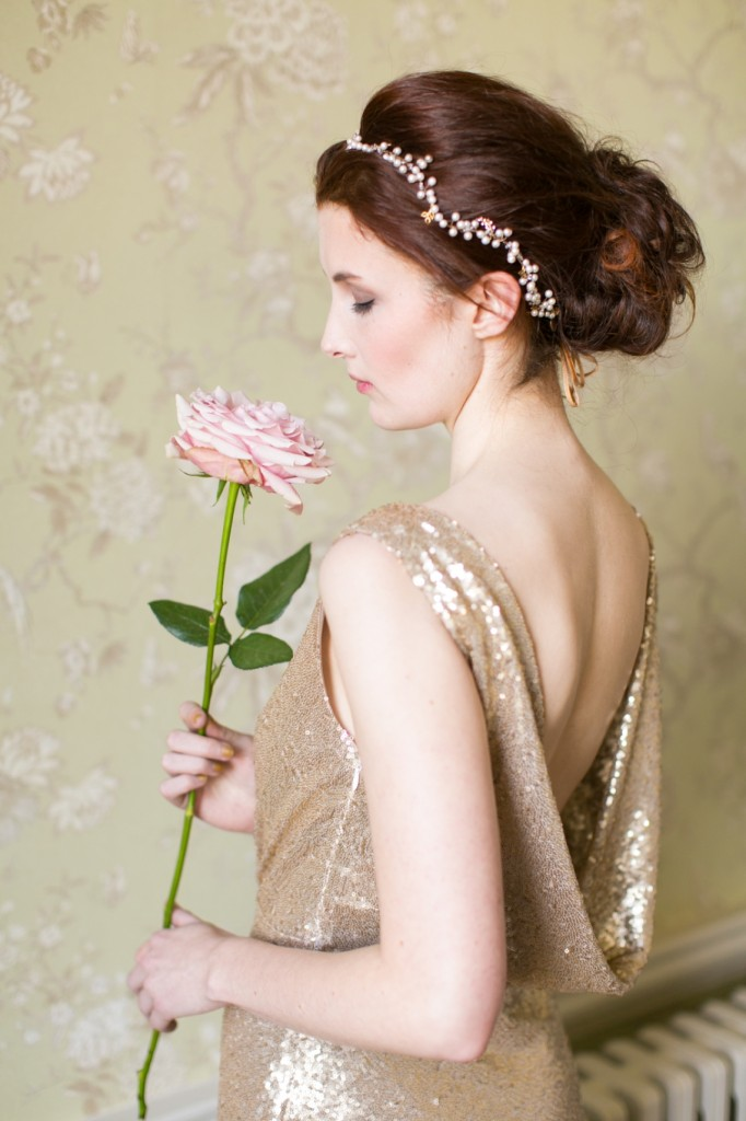 a single pink rose with a long stem is great for a glam bride who wants to look chic