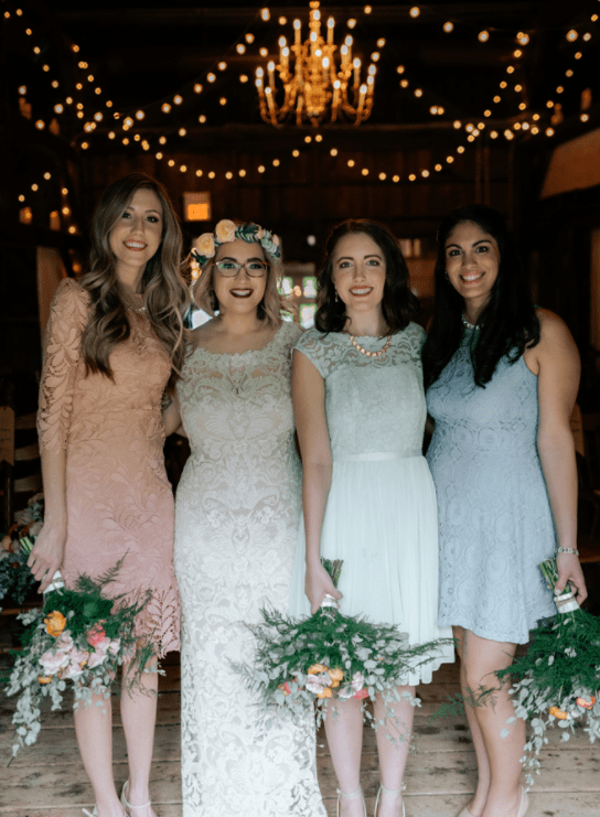 The bridesmaids were wearing lace gowns in pastel shades