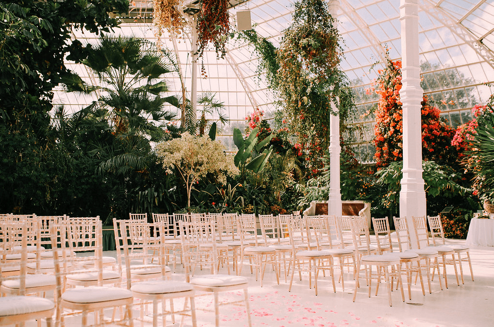 The ceremony took place in a botanical greenhouse