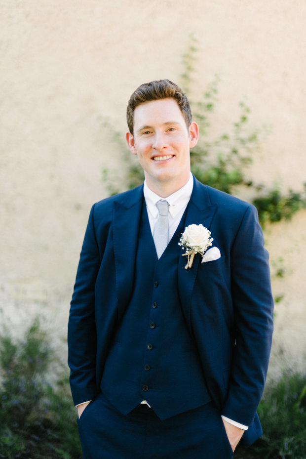 The groom was wearing a navy three-piece suit with a powder blue tie