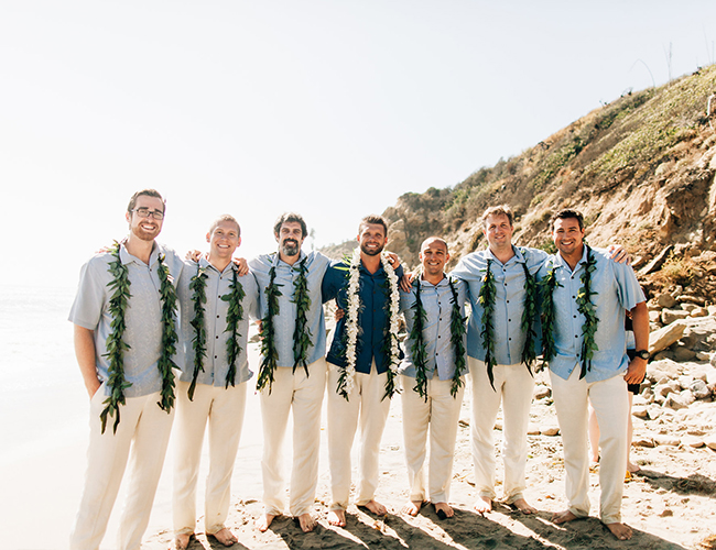 The groomsmen were wearing aqua blue shirts and white pants