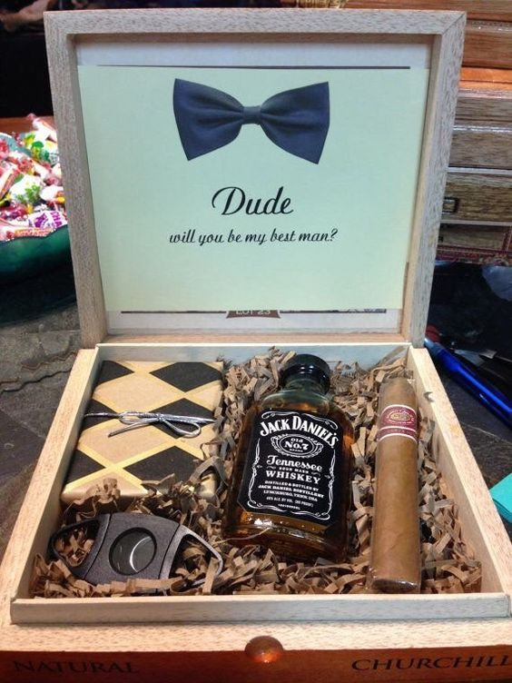 a box with whiskey, a cigar, a cigar cutter and a wallet for a stylish groomsmen proposal