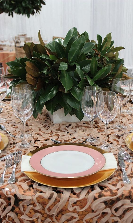 a cute greenery centerpiece of magnolia leaves is all you need for a chic look