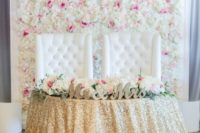 07 a floral wall of cream and pink blooms in a frame for a refined glam wedding