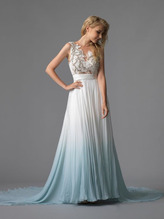 sleeveless wedding dress with a lace applique embellished bodice and an ombre blue skirt with a train