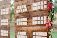 calligraphy wedding seating chart on a reclaimed wooden board