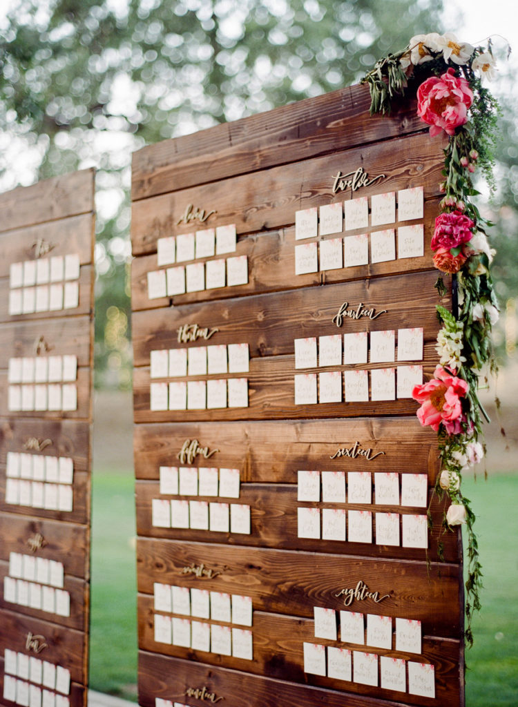 The wedding seating chart with calligraphy and florals