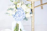 08 a beautiful bouquet of white blooms and blue hydrangeas, eucalyptus and with blue ribbons