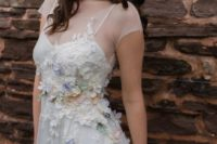 08 a cute illusion spaghetti strap wedding dress with a sheer top and realistic floral appliques on the whole dress