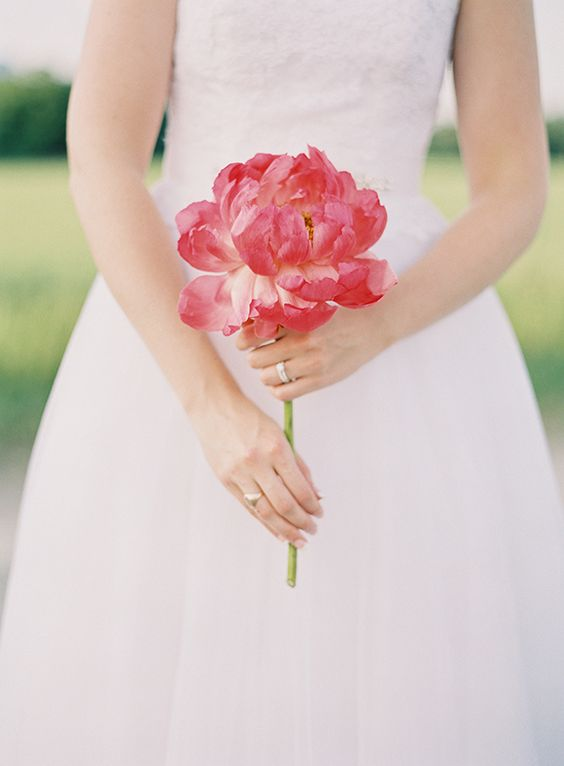 a large pink peony is all you need to look gorgeous on your big day