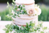 08 a naked cake with fresh foliage and a couple of neutral blooms for decor