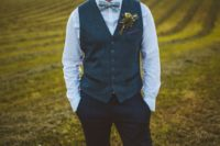 08 a navy suit with a waistcoat, a white shirt and a blue printed bow tie for an elegant and comfy look