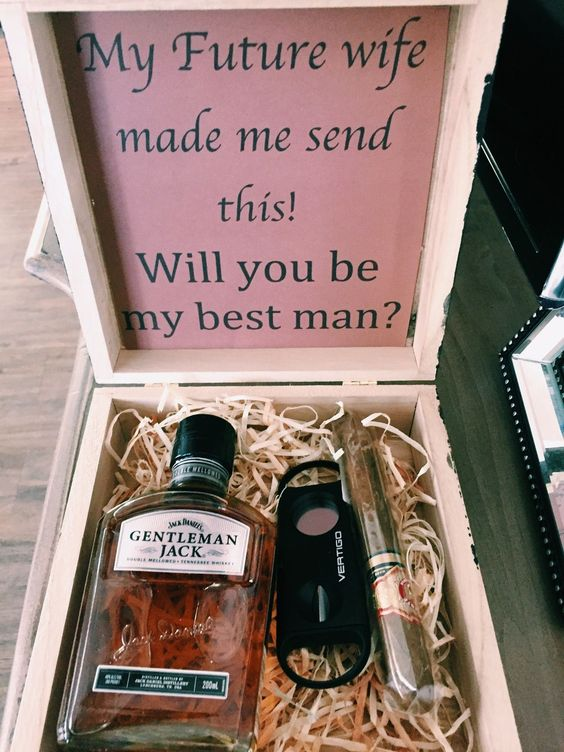 a traditional box with a bottle of alcohol, a cigar and a cigar cutter with a fun message
