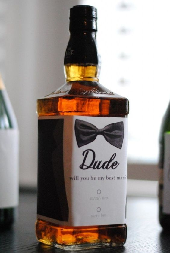 a whiskey bottle with a personalized label is a cool idea to pop up the question