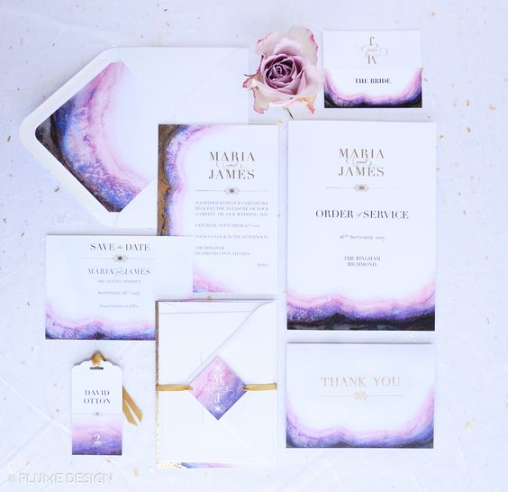 elegant amethyst-inspired wedding stationery set with gold touches and ribbons