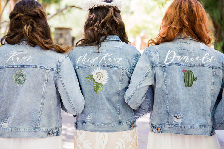 The bridesmaids were wearing distressed denim jackets with desert plants