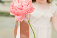 09 a large single pink peony is a cute idea for a little flower girl