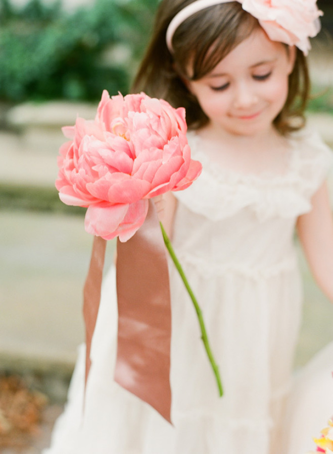 a large single pink peony is a cute idea for a little flower girl