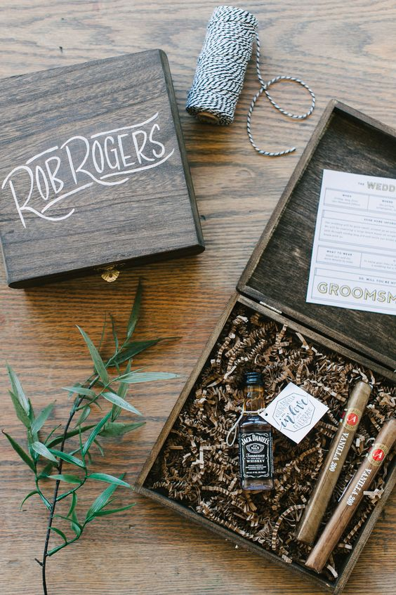 a stylish wooden box with whiskey and cigars for a stylish proposal