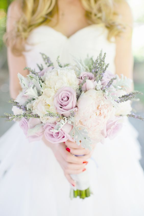 a sweet bouquet of white and dusty pink roses and some herbs looks cool and very romantic