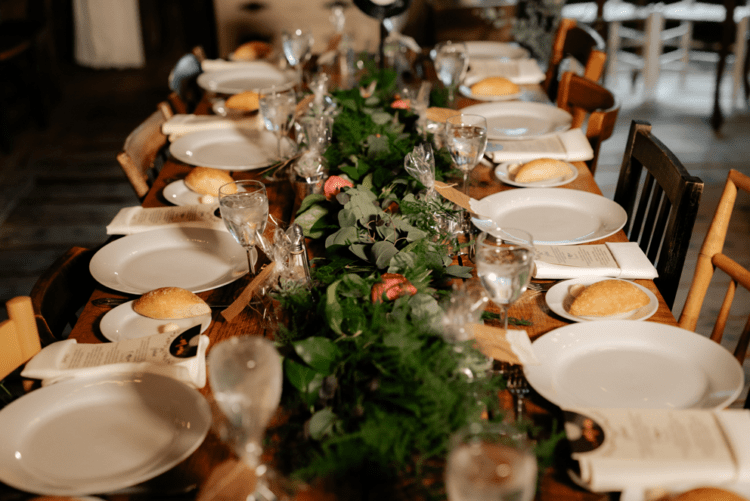 the stylish tablescape was done in rustic style, with a lush floral table runner