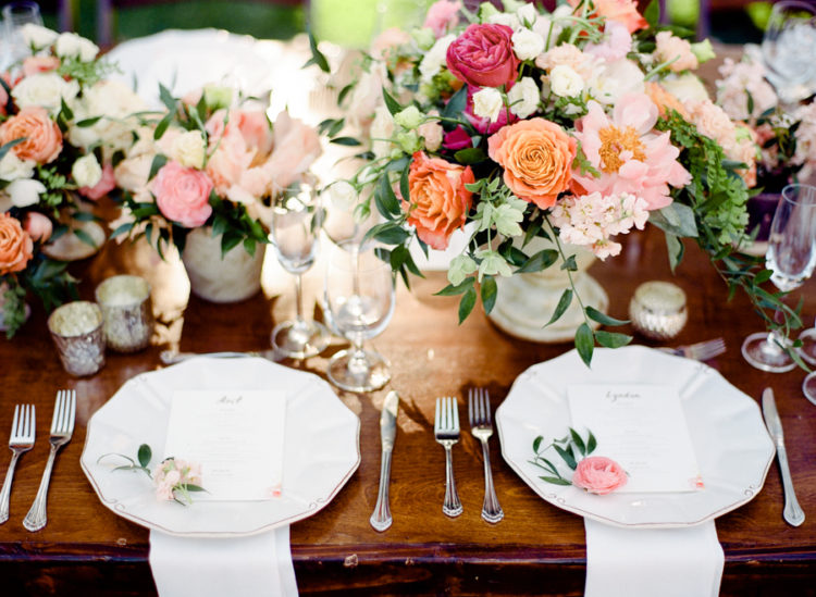The wedding tables were done with lush florals in the shades of pink